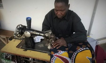 Tailored clothes are easy to get here, and people set up shop on street corners or in the market. They use the old Singer's, with a foot pedal, or rig up a newer machine to the foot pedal to work sans electricity.